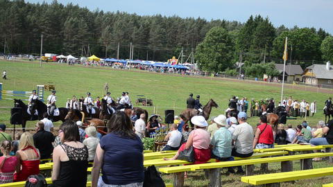 people watch various riders in annual horse festival Stock Video Footage