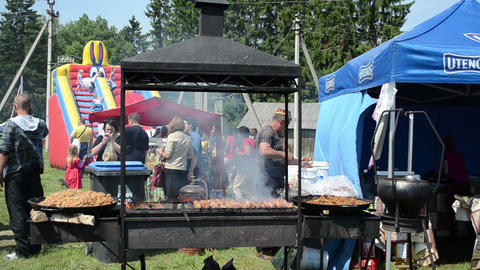 Smoke rise from baking meat, kids playing in playground Stock Video Footage