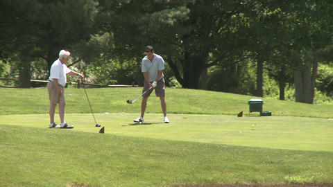 Male golfers tee off (4 of 4) Stock Video Footage