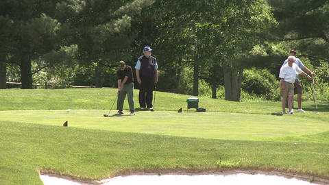 Male golfers tee off (2 of 4) Stock Video Footage