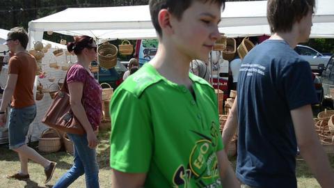 people choose wicker baskets in crafts market fair festival Stock Video Footage
