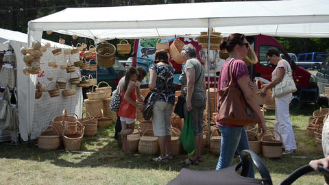 people choose wicker baskets in crafts market fair festival Footage