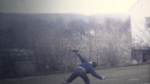 (8mm Vintage) 1965 Kid Throwing Baseball High Into Air Footage
