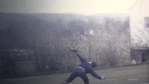 (8mm Vintage) 1965 Kid Throwing Baseball High Into Air Footage