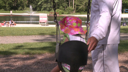 Baby swinging in park Stock Video Footage