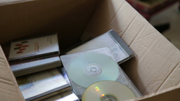 Throwing old cd cases Stock Video Footage