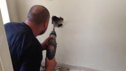 drilling a hole in a wall Stock Video Footage
