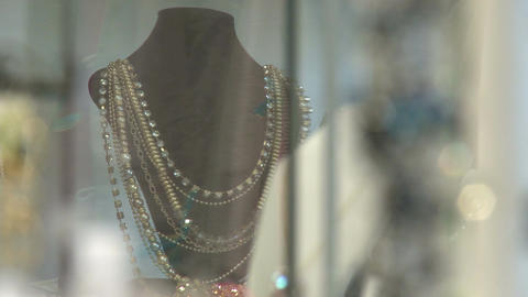 Necklaces in shop window Stock Video Footage