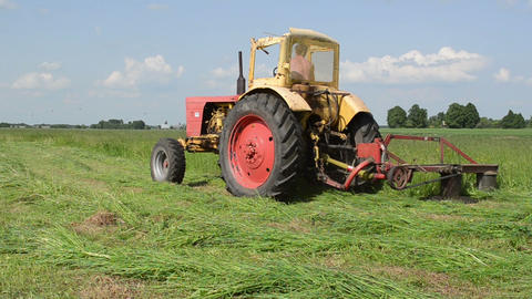 farmer mowing grass on summer Stock Video Footage