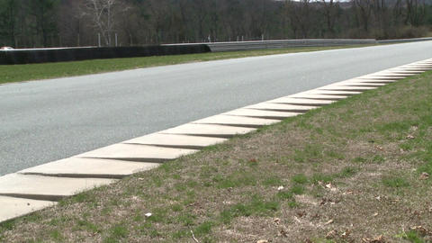 Speeding down a raceway (6 of 8) Stock Video Footage