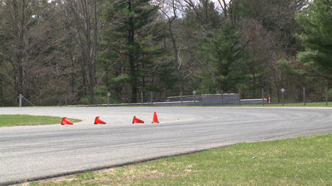 Racing cars speeding down a track (2 of 8) Stock Video Footage