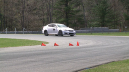 Racing cars speeding down a track (3 of 8) Stock Video Footage
