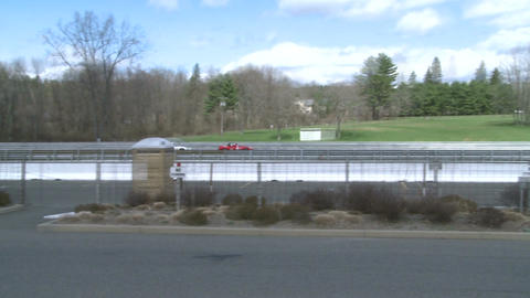 Race cars zooming around a track (3 of 8) Stock Video Footage