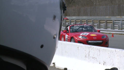 Race cars zooming around a track (2 of 8) Stock Video Footage