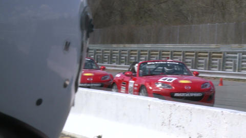 Race cars zooming around a track (2 of 8) Footage