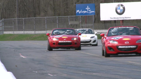 Race cars zooming around a track (4 of 8) Stock Video Footage