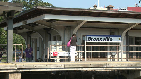 Woman waiting for a train at Bronxville Station Footage