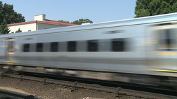 Train passing through local station Stock Video Footage