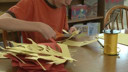 Child cutting out construction paper(2 of Footage