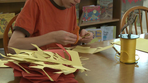Child cutting out construction paper(2 of Stock Video Footage