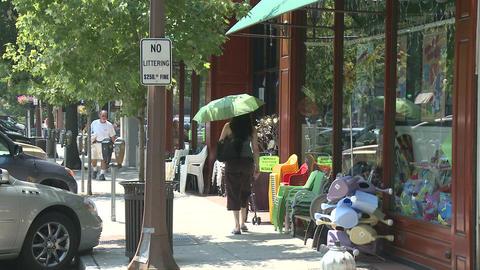 People walking down sidewalk (3 of 4) Footage