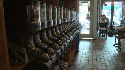 Coffee shop with coffee bean dispensers along wall(1 of 2) Footage