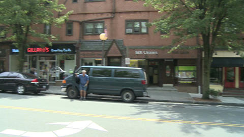 Man getting out a parked van downtown Stock Video Footage