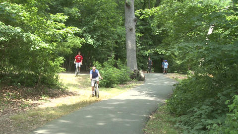 People walking and riding bikes in park (1 of 3) Stock Video Footage