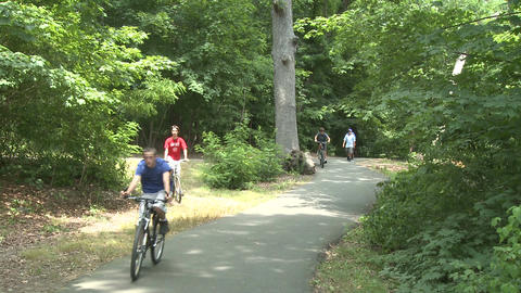 People walking and riding bikes in park (1 of 3) Footage