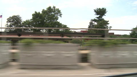 Riding by train station Stock Video Footage