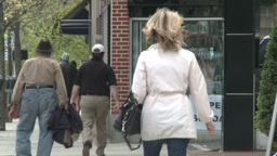 Woman walking down sidewalk (1 of 2) Live Action