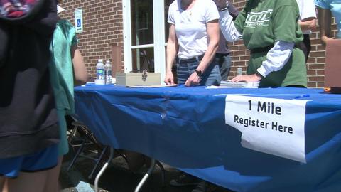 Registering marathon runners (1 of 3) Stock Video Footage