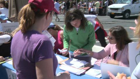 Registering marathon runners (3 of 3) Stock Video Footage
