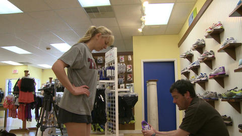 Girl in shoe store trying on athletic shoes (4 of 4) Live Action