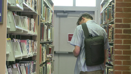 A student looking for a CD in the library Live Action