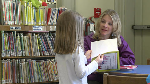 A child getting books for her mother to read to her (2 of 3) Live Action
