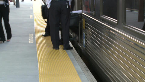 People exiting a commuter train Live Action