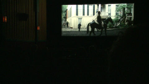 In side a movie house showing an old black and white movie (1 of 3) Footage