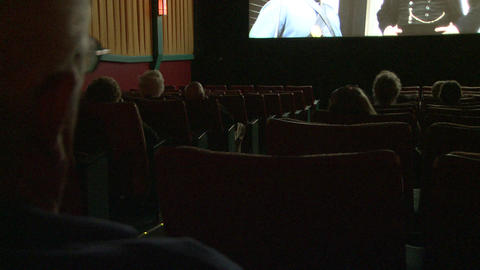 In side a movie house showing an old black and white movie (3 of 3) Footage