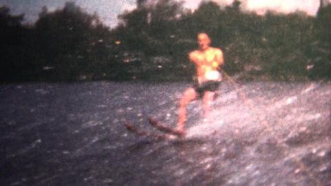 (8mm Vintage) 1966 Man Waterskiing Behind A Boat stock footage