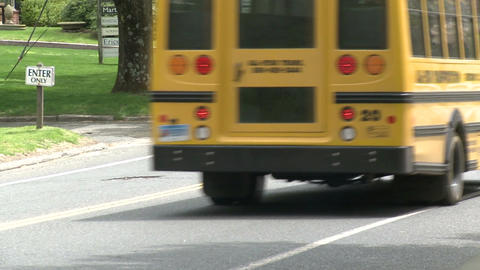 Small school bus traveling on road (5 of 5) Live Action