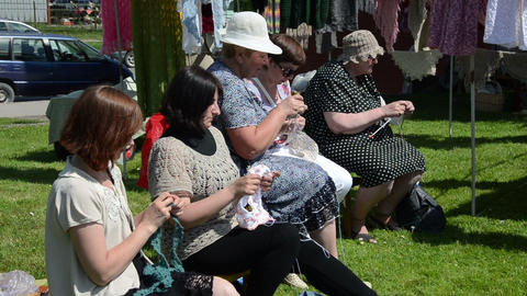 Women Of All Ages Knits Knitting Needles City Festival Summer stock footage