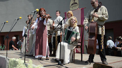 rural folk ensemble playing accordion violin bass on stage Footage
