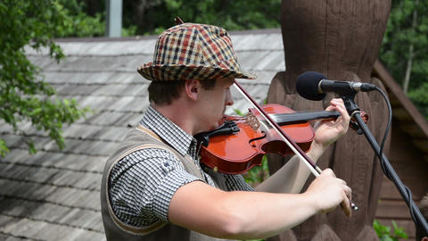 Violinist fiddler man play folk music with viola near microphone Footage