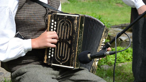 Accordionist man play folk music with accordion Footage