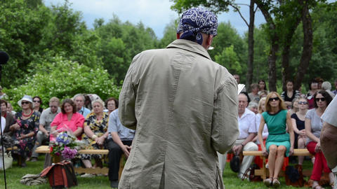 Famous poet read poem in poetry festival and people audience Footage