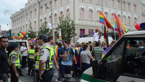 Police man force protect gay people parade participant in street Footage