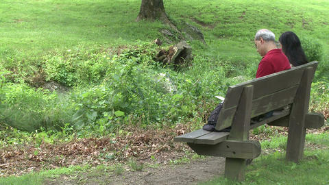 Two people sitting on a bench in a Nature Reserve (2 of 3) Live Action