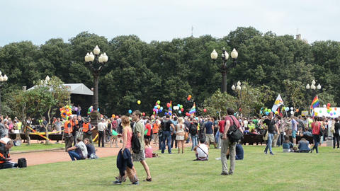 crowd gay parade members colored balloons flags on square Footage