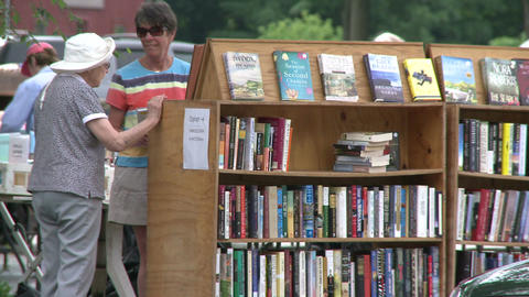 Books being displayed at an outdoor book fair (1 of 4) Live Action